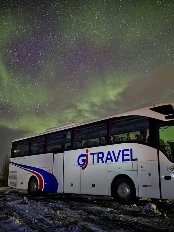 GJ Travel bus under the northern lights in Iceland